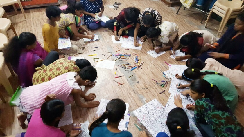 Child trafficking survivors coloring in India. (Courtesy of Kelly Galindo)