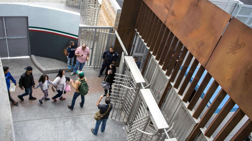 Central American migrants seeking for asylum in the United States, walk to the US-Mexico border at El Chaparral port of entry on November 12, 2017.