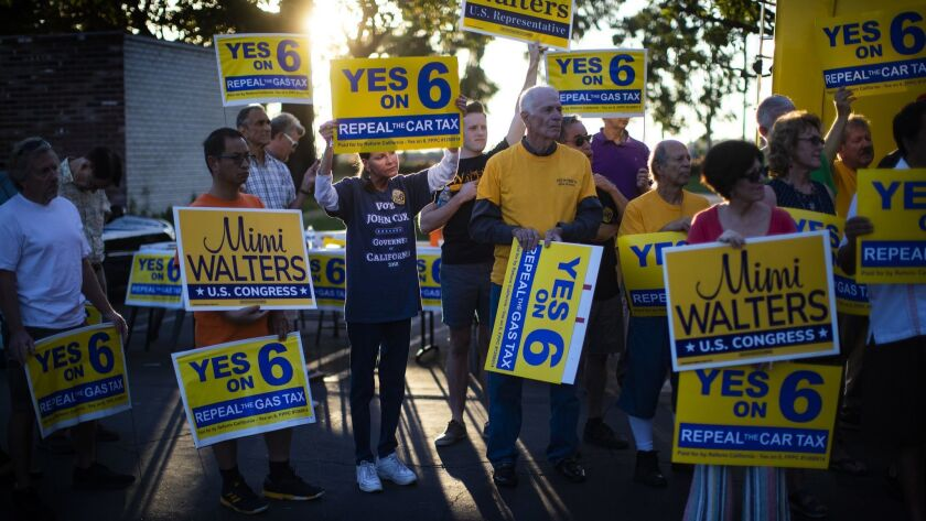 """IRVINE, CA - NOVEMBER 3, 2018: Supporters of """"Yes on Prop 6"""" to repeal the gas tax attend a rally"""