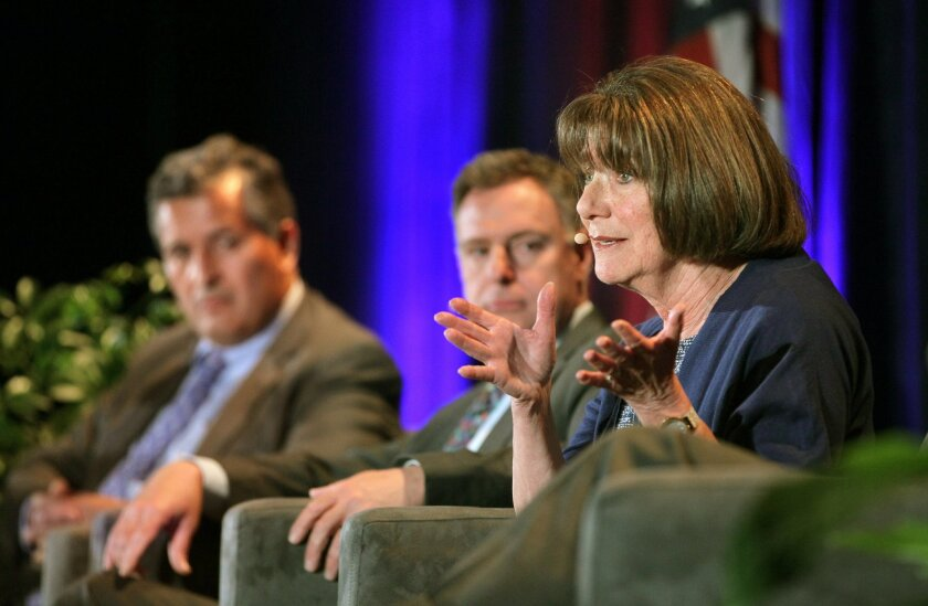 Rep. Susan Davis speaks during a panel discussion at the S.D. Chamber of Commerce Congressional Luncheon at the San Diego Marriott Marquis & Marina hotel as Reps. Juan Vargas, left, and Scott Peters listen.