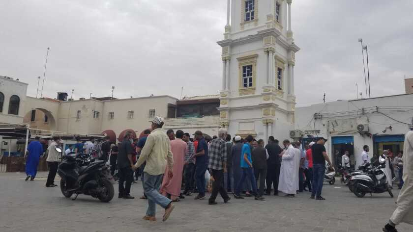 A Hilga, or circle of unlicensed cureency traders in Tripoli's Musheer market.