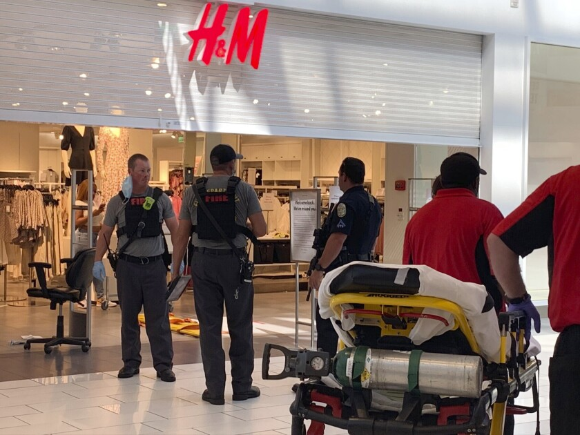 Authorities continue their investigation of a shooting at Riverchase Galleria Wednesday in Hoover, Ala.