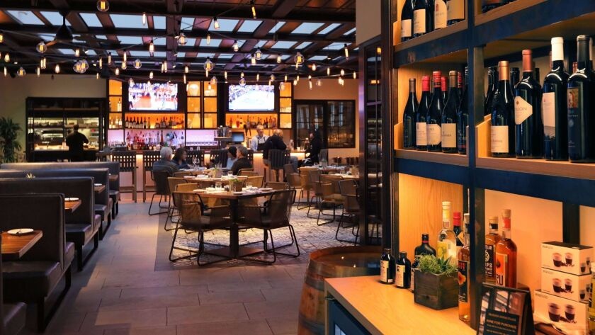 The wine shop and main dining room at Seasons Restaurant at the Four Seasons Residence Club Aviara in Carlsbad. Previously only open to time-share villa owners, the restaurant opened to the public on Jan. 1, 2017.
