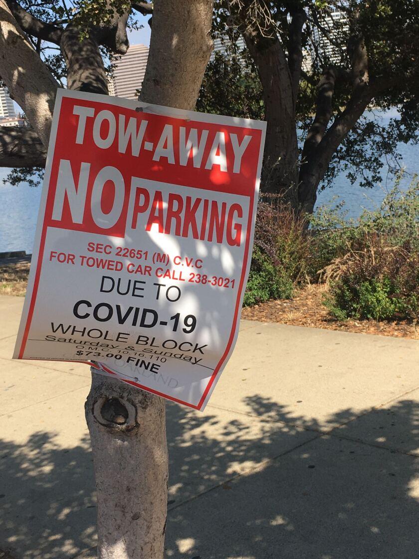 A sign warns motorists away from Lake Merritt in Oakland.