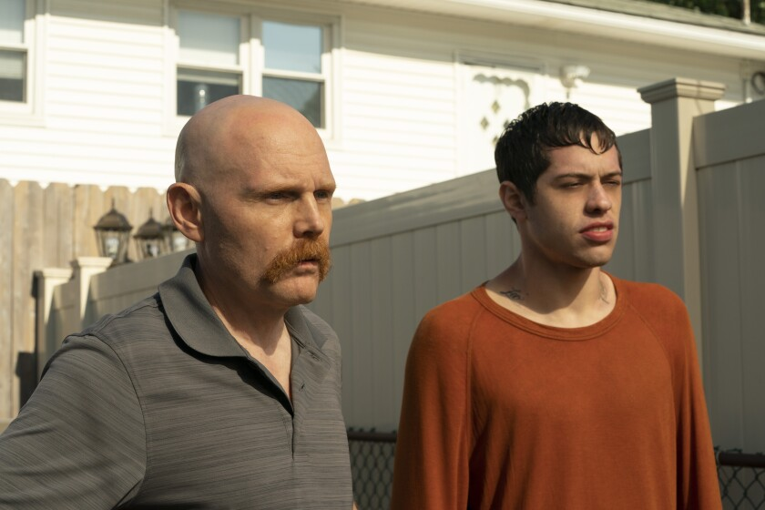 "Bill Burr and Pete Davidson in ""The King of Staten Island."""