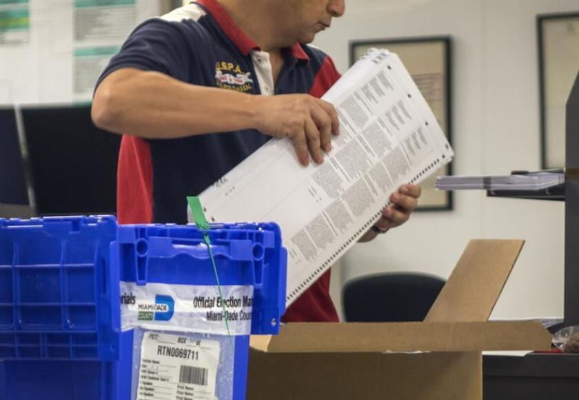 A staff member of the Miami Dade County Election Department works on the recount of the mid-term election vote at the Miami-Dade Election Department in Miami, Florida, USA. EFE/EPA
