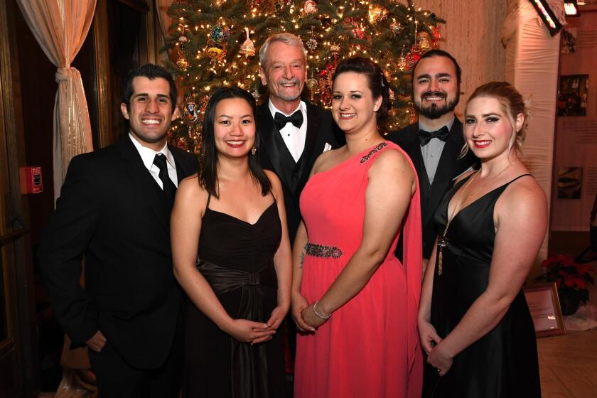 Students A.J. Paulin and Danita Lee, professor Loren Schreiber, students Caroline J. L. Andrew, John Munoz, and Jessica Gilliard (all are from SDSU; the students are a collaborative study group that designed and built the ornament exhibition)