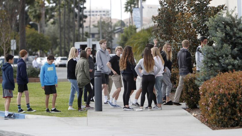 A small group of Corona del Mar High School students briefly step out of class, at 10:22 AM, before