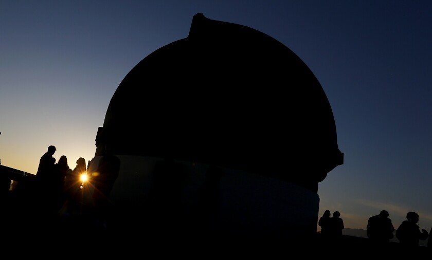 Visitors take in the sunset from the roof of the Griffith Observatory