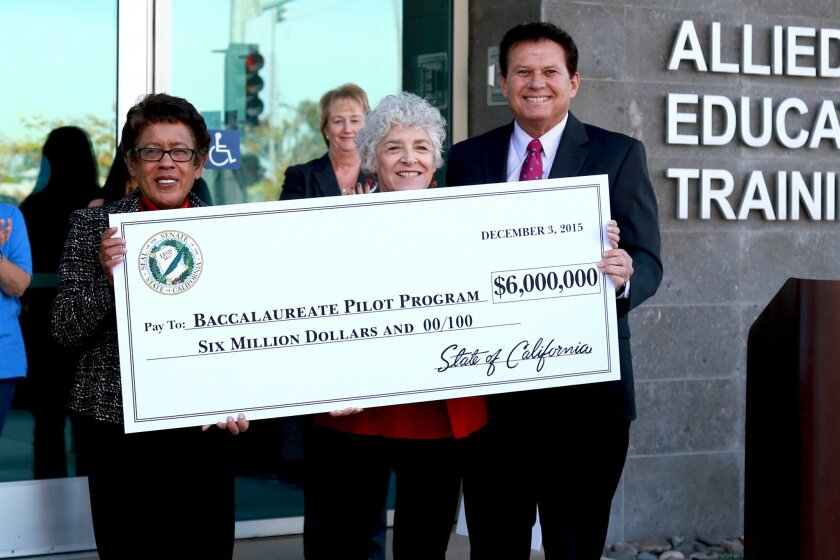 State Senator Marty Block visited Mesa College to announce he had secured $6 million for a pilot program that allows 15 community colleges to offer four-year degrees. Show left to right are  San Diego Community College District Chancellor Constance Carroll, board President Maria Senour and block. M