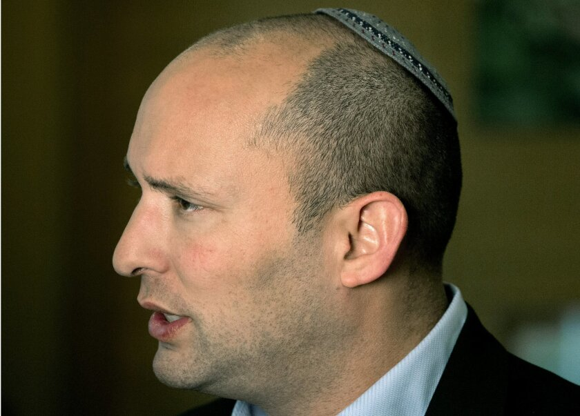 FILE - In this Monday, Feb. 16, 2015 file photo, Naftali Bennett, leader of the Jewish Home party, speaks during an interview to The Associated Press in Jerusalem. Israel's high school civics textbook, slated to be published in March, has become the latest in a string of national battles over what
