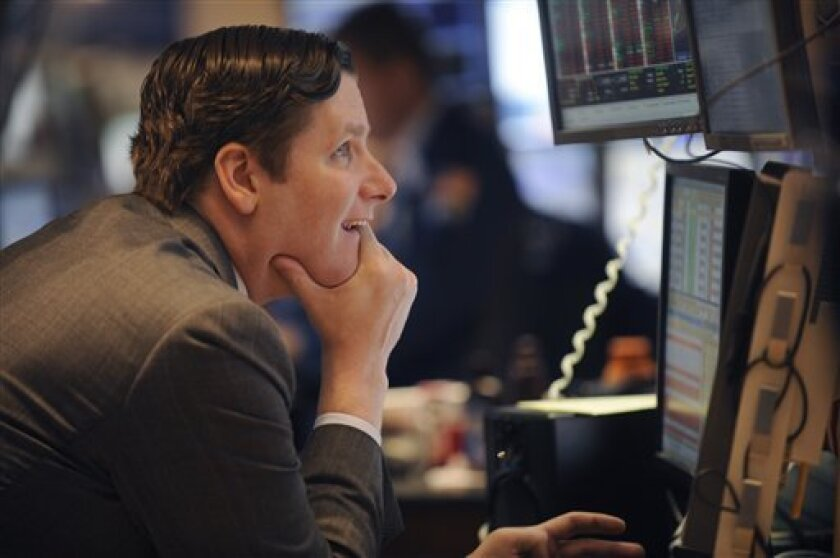 In this Sept. 6, 2011 photo, Gregg Maloney of Barclays Capital, works on the floor of the New York Stock Exchange. Global stocks rebounded Wednesday, Sept. 7, from the previous day's steep sell-off as investor sentiment was buoyed by a German court decision backing the country's participation in European bailouts. The Swiss franc, meanwhile, hovered around the level it was pegged at. (AP Photo/Henny Ray Abrams)