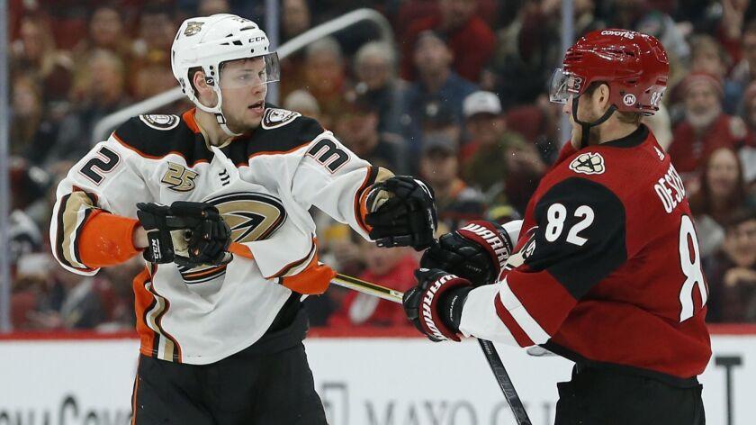 Anaheim Ducks defenseman Jacob Larsson (32) and Arizona Coyotes defenseman Jordan Oesterle (82) in t