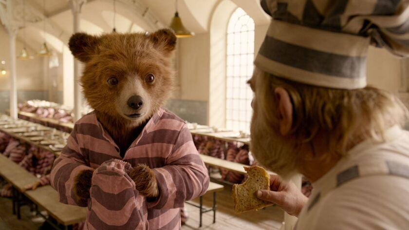 L-R) Paddington voiced by BEN WHISHAW and BRENDAN GLEESON as Knuckles McGinty in the family adventur