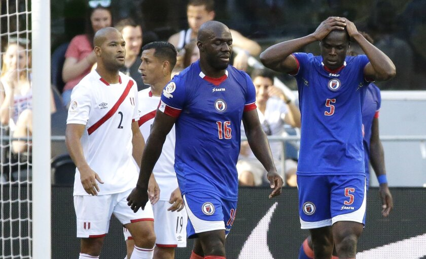 Haiti defender Romain Genevois (5) and midfielder Jean Marc Alexandre (16) react after a shot by a teammate went wide of the goal in the second half of a Copa America Centenario soccer match, Saturday, June 4, 2016, in Seattle. Peru beat Haiti 1-0. (AP Photo/Ted S. Warren)