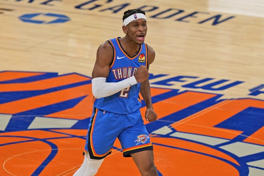 Oklahoma City Thunder's Shai Gilgeous-Alexander reacts after sinking a basket during the second half of an NBA basketball game against the New York Knicks, Friday, Jan. 8, 2021, in New York. (AP Photo/Seth Wenig, Pool)