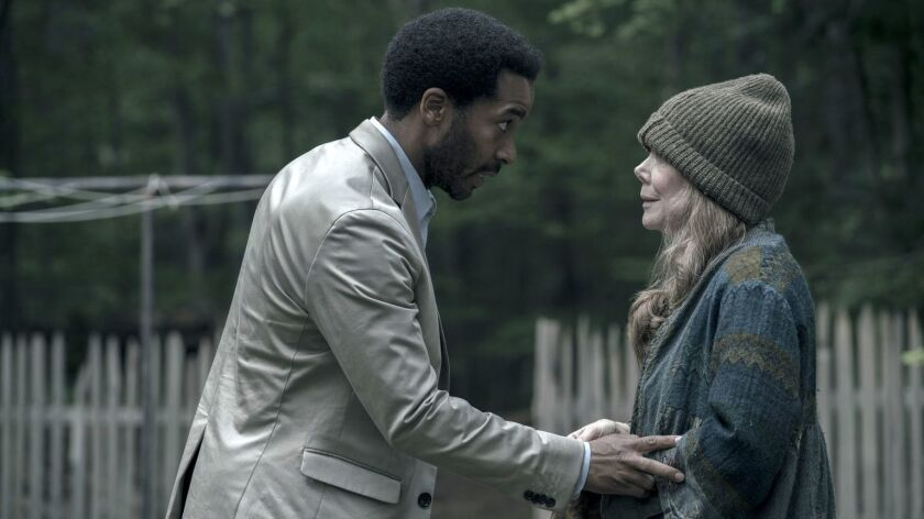 "This image released by Hulu shows Andre Holland, left, and Sissy Spacek in a scene from ""Castle Rock"