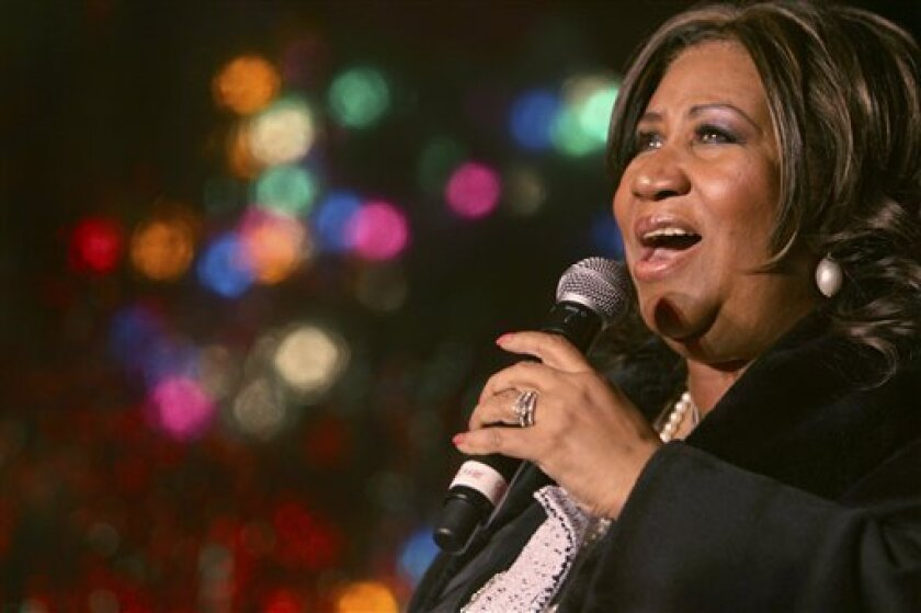 """In this Dec. 4, 2008 file photo, Aretha Franklin performs during the 85th annual Christmas tree lighting at the New York Stock Exchange in New York. The Queen of Soul also has made her way to Washington and said she would be singing for """"two of the greatest men in history"""" _ Dr. Martin Luther King"""