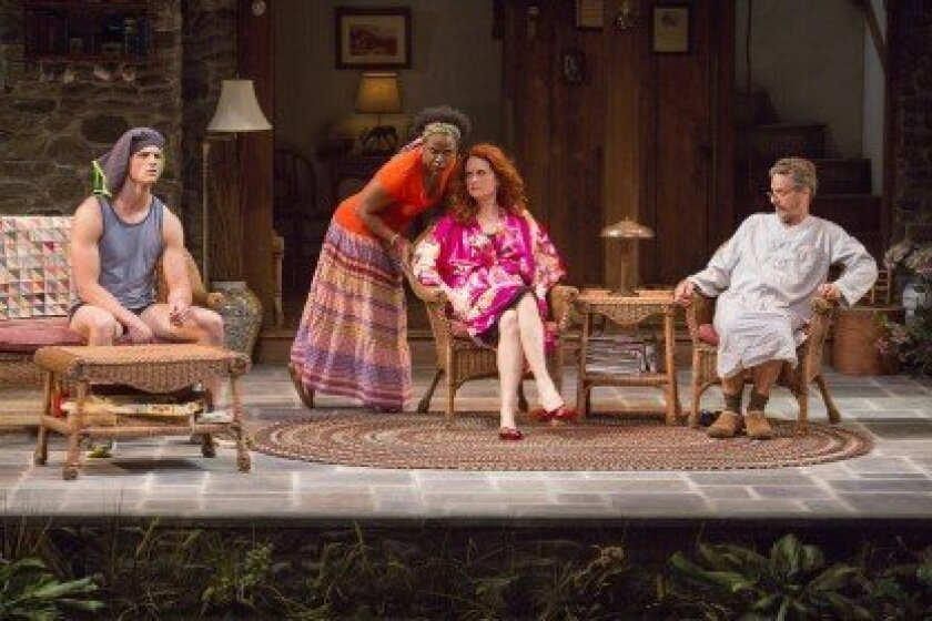 Haneefah Wood (Cassandra), Candy Buckley (Masha), and Martin Moran (Vanya) appear in the San Diego premiere of 'Vanya and Sonia and Masha and Spike' through June 22 at The Old Globe Theatre.  Jim Cox