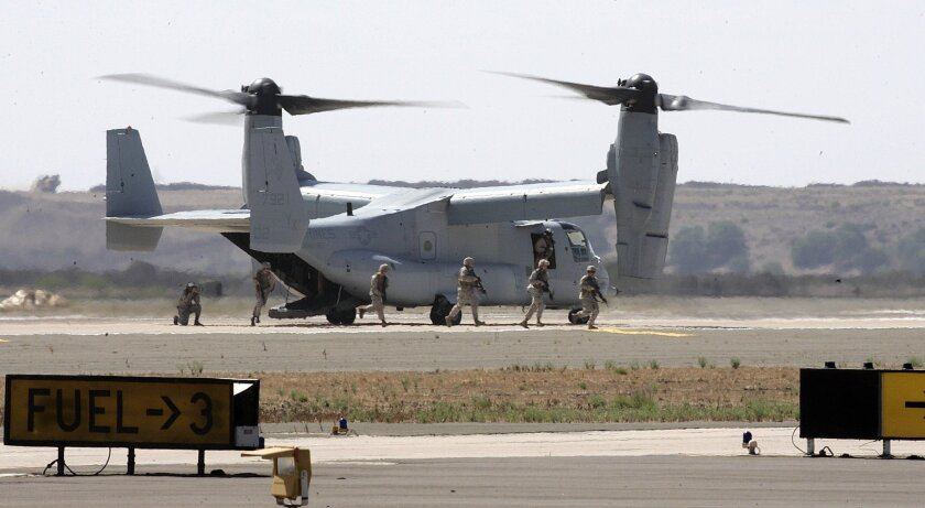 Marines file out of an MV-22A Osprey in a demonstration of the Marines' Marine Air-Ground Task Force during the airshow.