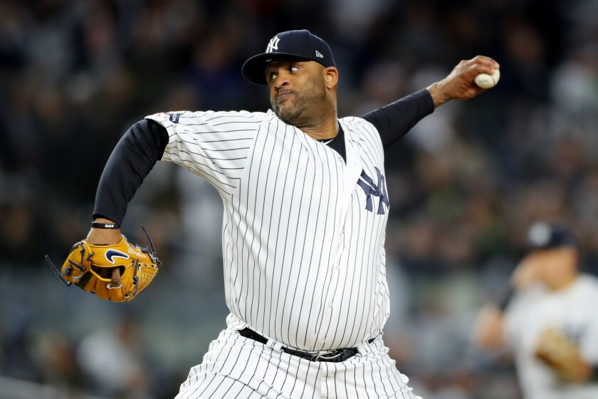 Yankees pitcher CC Sabathia pitches during Game 4 of the ALCS.