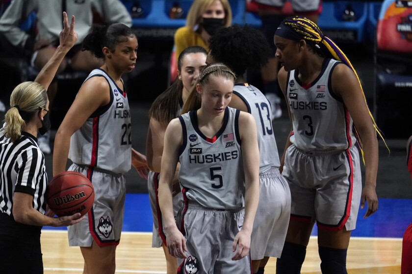 Connecticut guard Paige Bueckers (5) reacts after getting fouled during the second half of a women's Final Four NCAA college basketball tournament semifinal game against Arizona Friday, April 2, 2021, at the Alamodome in San Antonio. (AP Photo/Eric Gay)