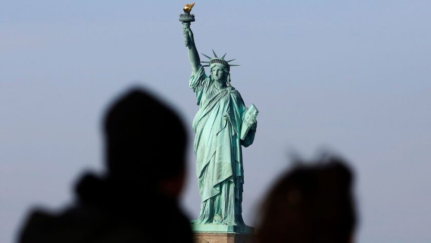 Tourists ride the Staten Island Ferry to get a view of the Statue of Liberty in New York City on Jan. 21.