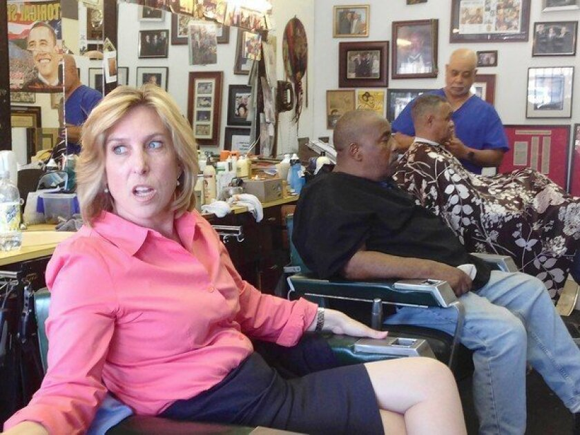Mayoral candidate Wendy Greuel settles in for another chat with the regulars at Tolliver's barbershop in South Los Angeles.