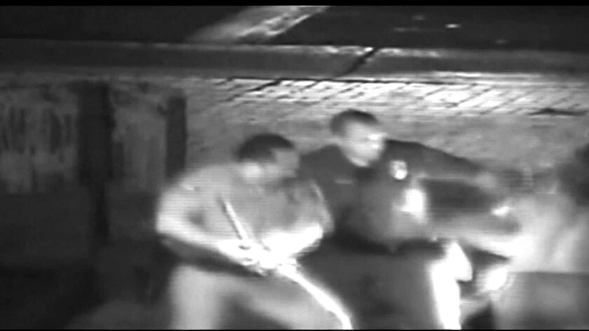 A shirtless Kelly Thomas is shown being hit by Fullerton police officers in a frame grab from video.
