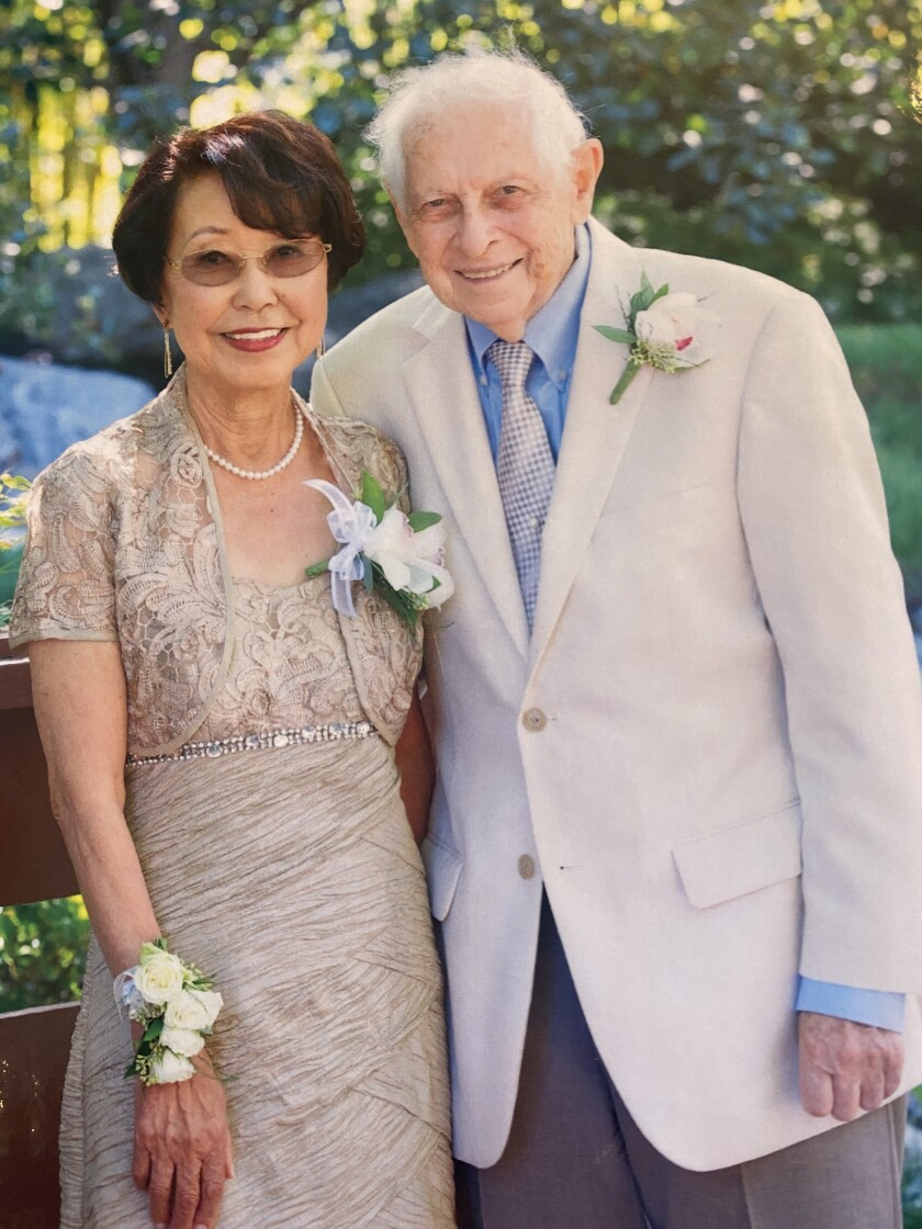 Peter Manes and his second wife, Yoko Sakaguchi, on their wedding day in 2014.
