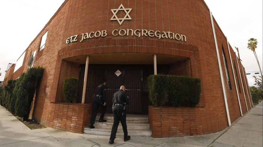 LOS ANGELES, CA - FEBRUARY 14, 2019 - - Los Angeles police officers head to the entrance of Etz Jaco