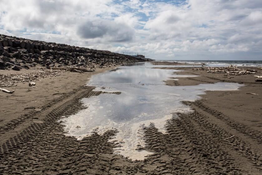 The tide comes in along the Chukchi Sea in Shishmaref, Alaska.