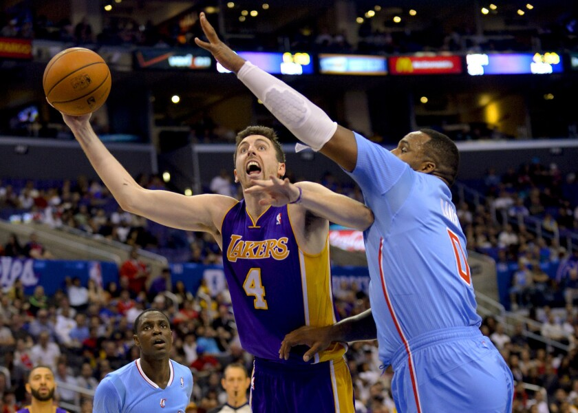 Lakers forward Ryan Kelly drives against Clippers forward Glen Davis on April 6.