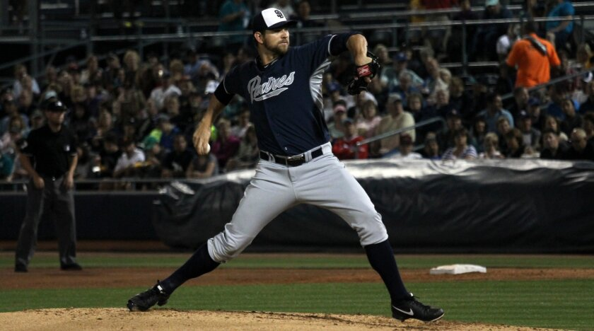 Padres pitcher Josh Johnson throws against the Mariners during spring training in Peoria, Ariz.