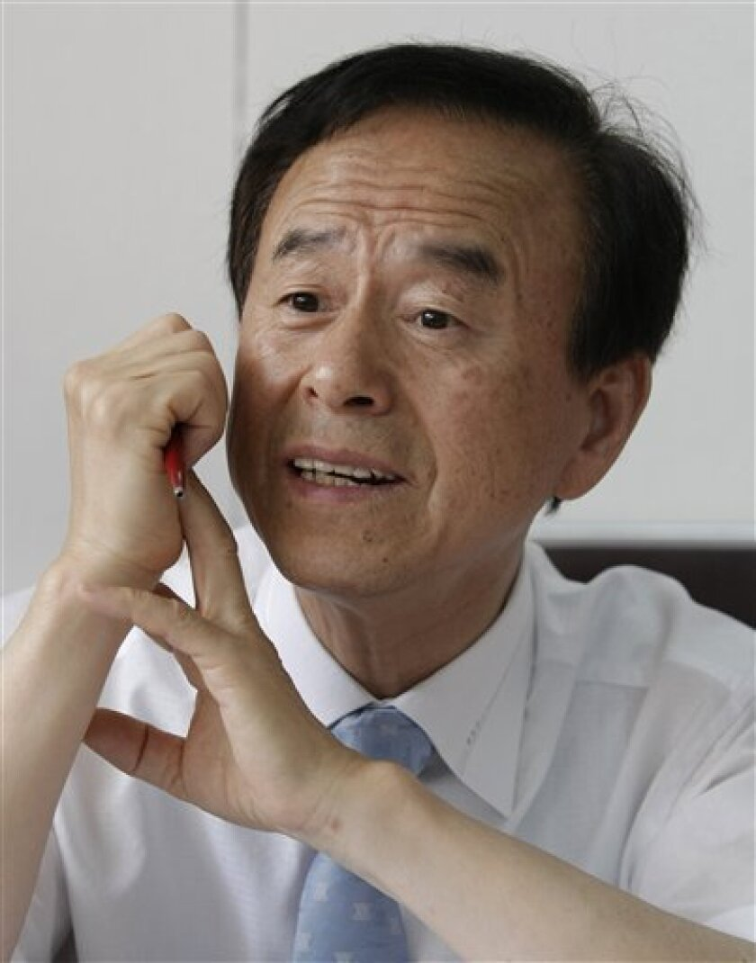 In this June 9, 2010, photo, Lee Won-woo, who was 2 years old when his parents and older sister were killed with some 70 other refugees in an attack by a U.S. aircraft near Kyongju, talks during an interview with The Associated Press in Seoul, South Korea. In a political about-face, ending a four-y