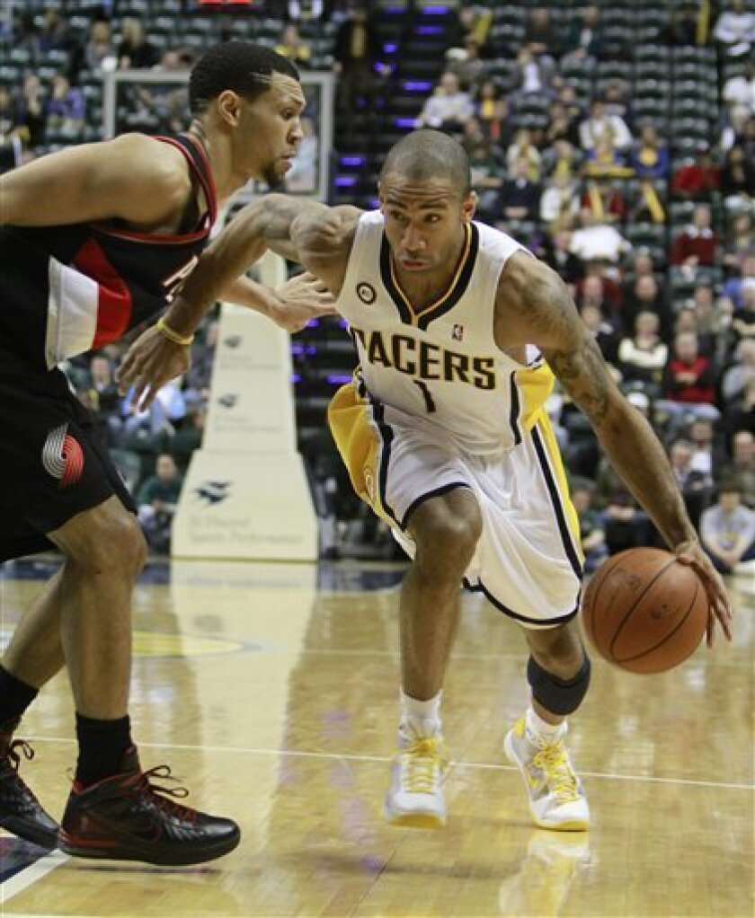 Indiana Pacers guard Dahntay Jones, right, drives to the basket against Portland Trail Blazers guard Brandon Roy during the fourth quarter of an NBA basketball game in Indianapolis, Wednesday, Dec. 9, 2009. Portland won 102-91. (AP Photo/Darron Cummings)