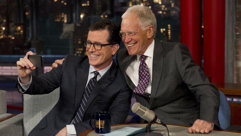 "Stephen Colbert, left, and David Letterman on CBS's ""Late Show with David Letterman."""