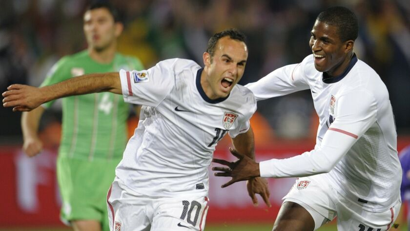 Landon Donovan celebrates his goal with teammate Edson Buddle during the Group C, first round, 2010 World Cup soccer match USA vs. Algeria on June 23, 2010 at Loftus Verfeld stadium in Tshwane/Pretoria.