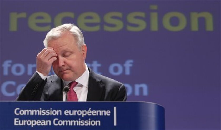 European Commissioner for Economic and Monetary Affairs Olli Rehn addresses the media at the European Commission headquarters in Brussels, Friday, May 3, 2013. The European Union is predicting that the recession in the Eurozone will continue in 2013 and that unemployment will stand at record levels. In Friday's spring economic forecast, the EU said that gross domestic product in the 17 nations that use the euro currency will shrink by 0.4 percent this year, slightly better that the estimated -0.