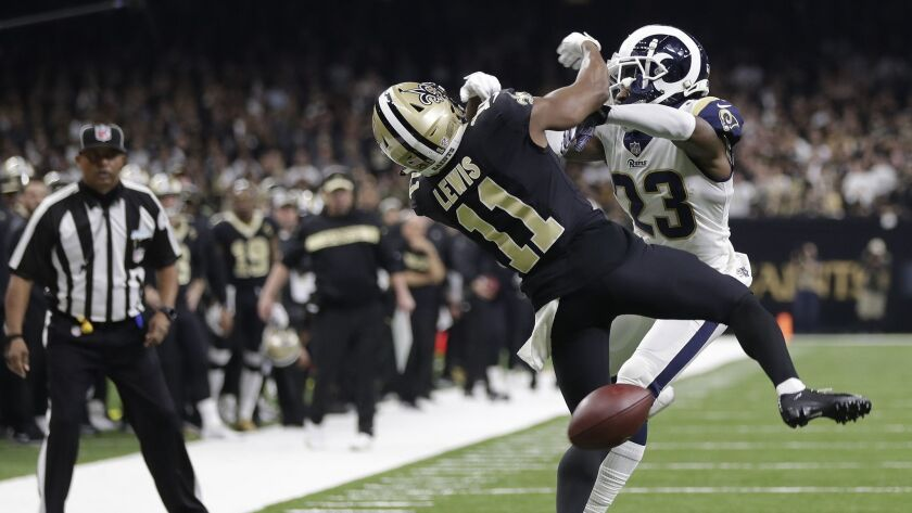 New Orleans wide receiver Tommylee Lewis works for a catch against Rams defensive back Nickell Robey-Coleman during the NFC Championship Game.
