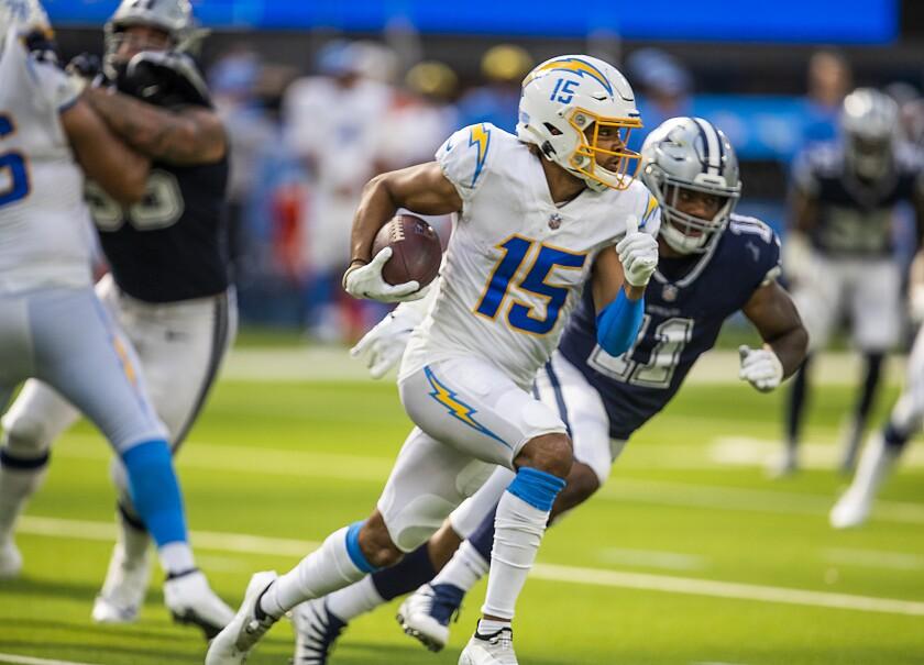 Chargers wide receiver Jalen Guyton runs past Dallas Cowboys linebacker Micah Parsons.