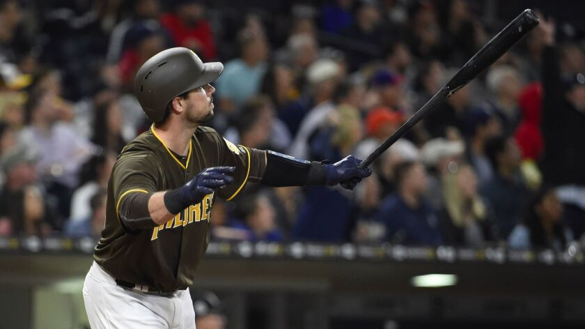 Austin Hedges of the San Diego Padres hits a three-run home run during the seventh inning of a baseball game against the Miami Marlins at Petco Park on April 21, 2017, in San Diego, California.