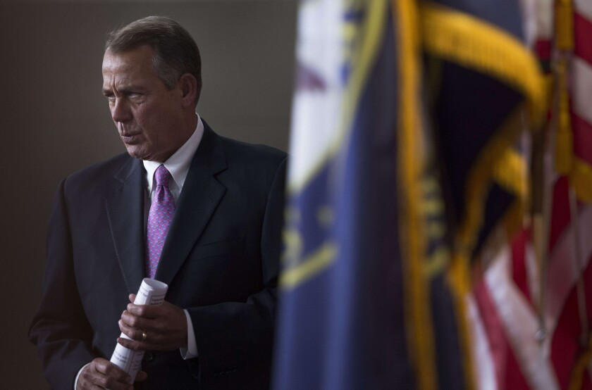 House Speaker John A. Boehner (R-Ohio) arrives for a news conference on Capitol Hill.