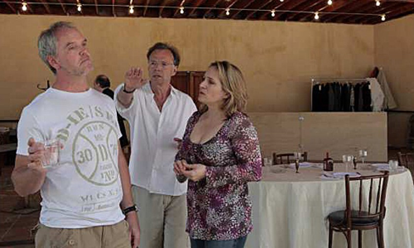 """Director Jonathan Kent, center, in a rehearsal for """"The Letter"""" with Anthony Michaels-Moore  and Patricia Racette."""