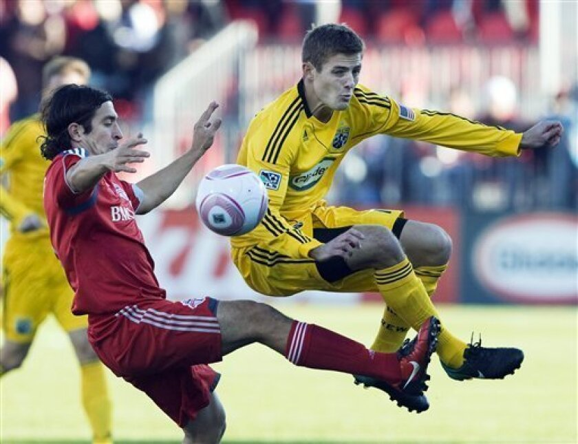 FILE - In this Oct. 16, 2010, file photo, Toronto FC defender Nick Garcia, left, battles for the ball against Columbus Crew midfielder Robbie Rogers, right, during first half MLS soccer action in Toronto. Former MLS and U.S. national team player Robbie Rogers says he is gay. In a post on his person