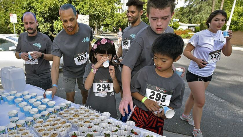 Runners and walkers stop at one of the chocolate stations for treats along the course of the 3rd ann