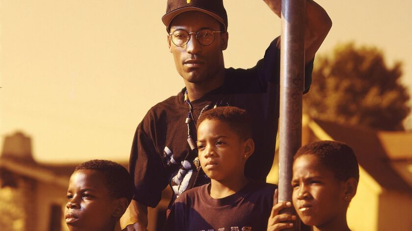 """In 1991, John Singleton, center, became the youngest Academy Award nominee for best director for his debut film, """"Boyz n the Hood."""""""