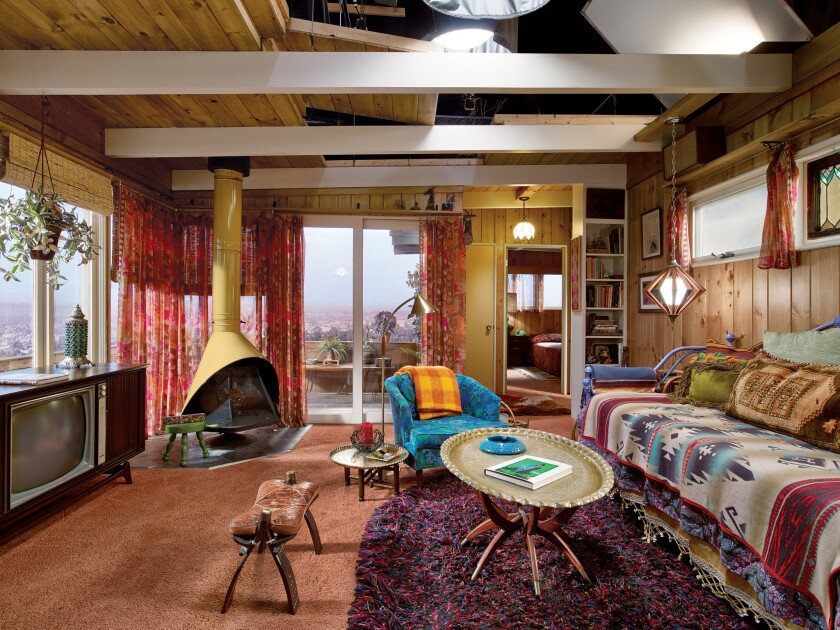 'Mad Men' set decorator Claudette Didul based Megan Draper's Laurel Canyon home on a 1952 bungalow. The living room features a midcentury Wendell Lovett fireplace and ethnic accents such as brass tray tables, a camel saddle stool, Scandinavian rugs and Southwestern and Mexican textiles.