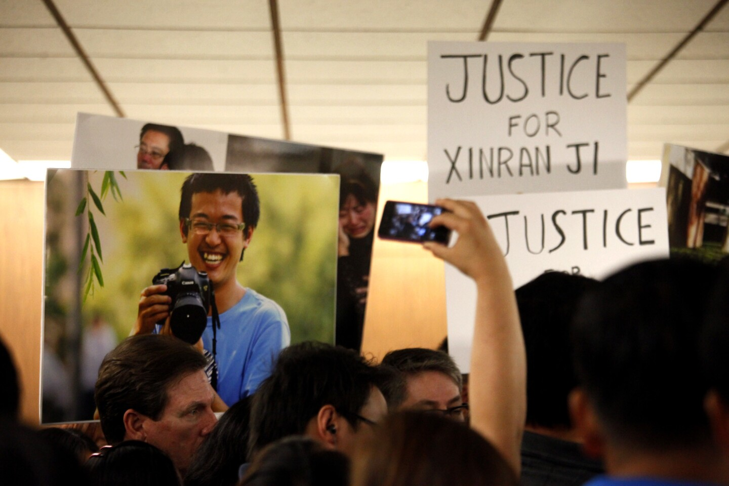 Supporters of slain USC student Xinran Ji, in photo, gather for a press conference after the arraignment of Jonathan Del Carmen, Andrew Garcia, Alberto Ochoa and Alejandra Guerrero in downtown Los Angeles.