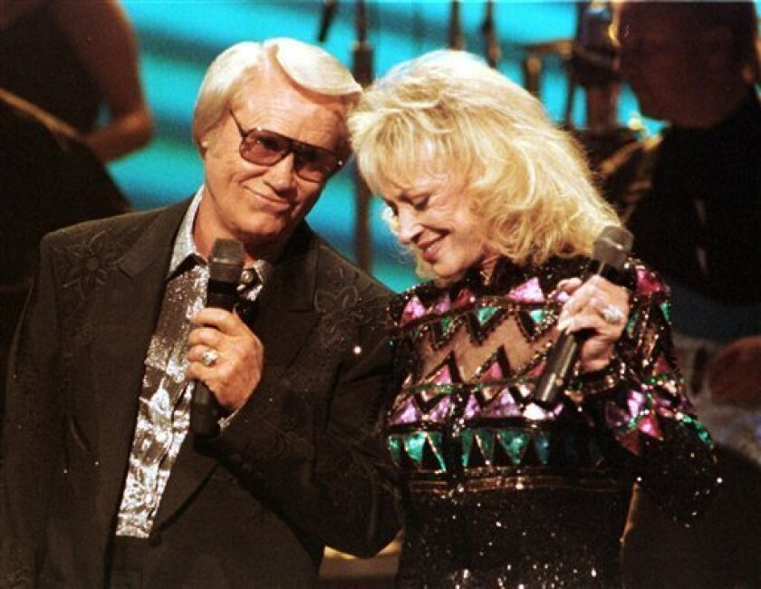 FILE - In this Oct. 5, 1995 file photo, Tammy Wynette appears with duet partner and former husband George Jones in Nashville, Tenn. (AP Photo/Christopher Berkey, file)